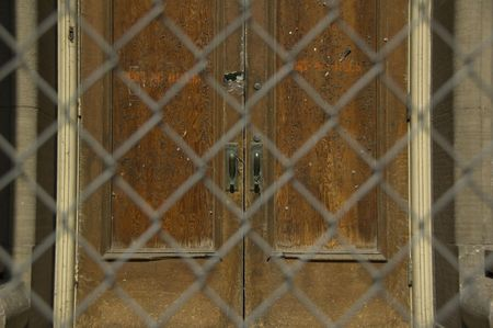 chainlink: Old door behind chainlink fence