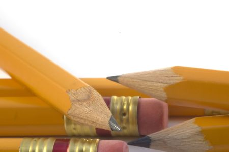 Lead pencils on a white piece of paper Stock Photo