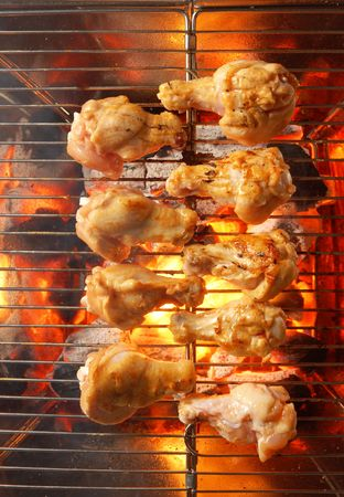 Chicken on the grill with flames  Stock Photo