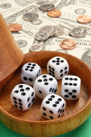 Five dice with a wood dice cup photo