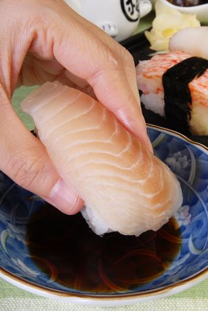 Takes up the sushi with the hand photo