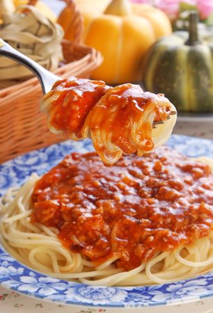 Spaghetti fresh on fork close up shoot   photo