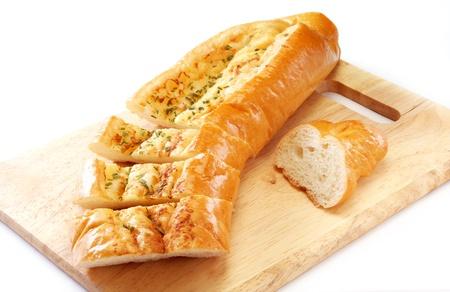 Garlic bread on wooden board photo