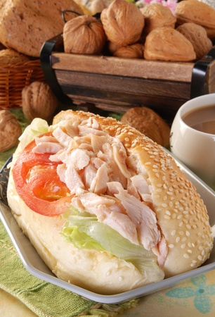 Sandwich with smoked chicken , tomatoes and lettuce  photo