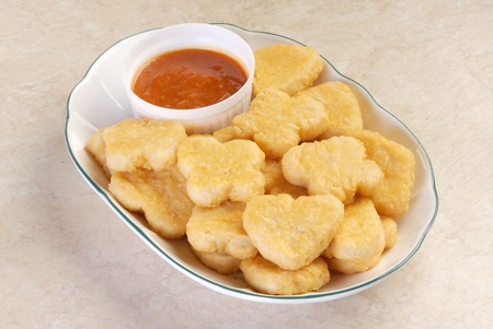 dinnertime: Fried chicken nuggets on a plate