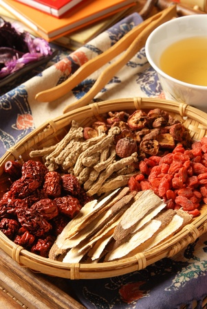 Different kind of Chinese herbal medicine on wicker baskets Stock Photo