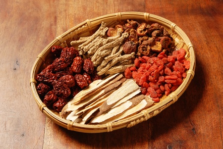 dried herb: Different kind of Chinese herbal medicine on wicker baskets Stock Photo