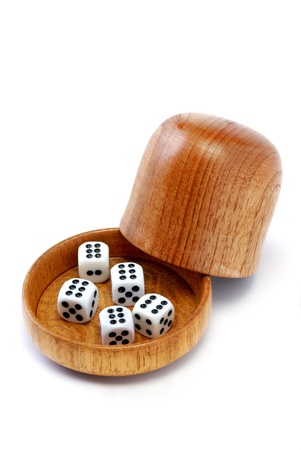 Five dice with a wood dice cup Stock Photo - 8684505