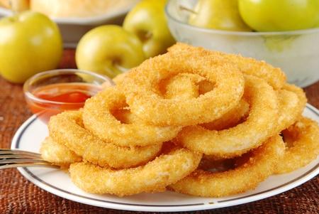 grasas saturadas: Salsa de tomate y aros de cebolla dorada