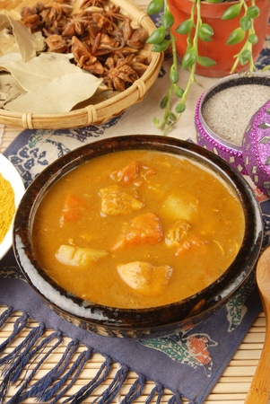 Chicken curry in black bowl Stock Photo - 8947052