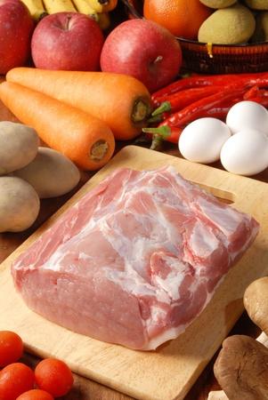 loin chops: Fresh pork loin chops on the wooden cutting board Stock Photo