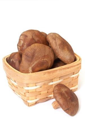 Some  asian shiitake mushrooms in a basket photo