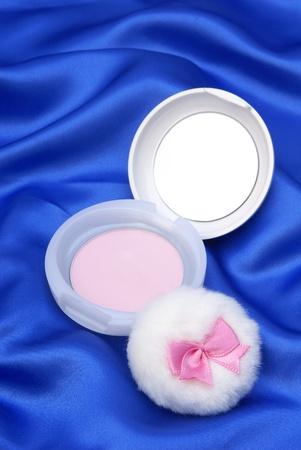 Face powder on blue  background photo