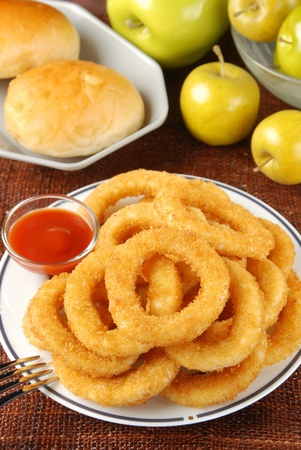 Golden onion rings and ketchup  photo