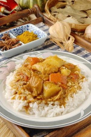 Chicken curry over steamed white rice. photo