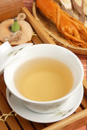 Chinese traditional ginseng tea and herbs photo
