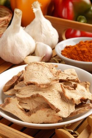 galangal: Dried galangal on a plate