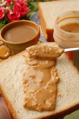 peanut butter and jelly: Peanut butter smeared on toast    Stock Photo
