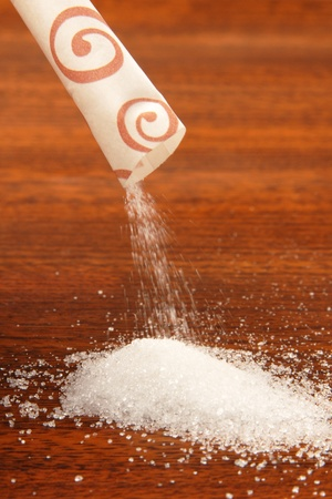 Sugar packet on a wooden table      photo