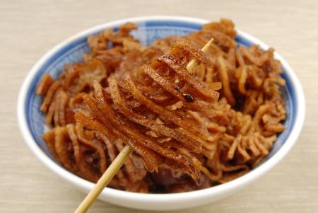 sapid: Stewed tofuskin on a stick  Stock Photo