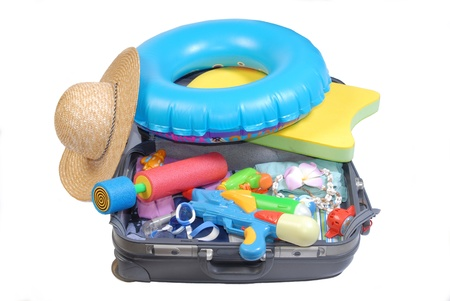 water gun: Open suitcase with water gun  and toy and beach items Stock Photo