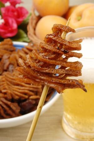 stewed: Stewed tofuskin on a stick  Stock Photo