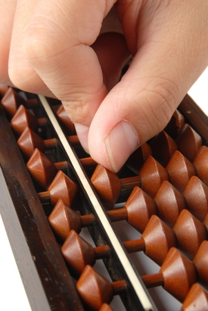 A hand accounting with the abacus