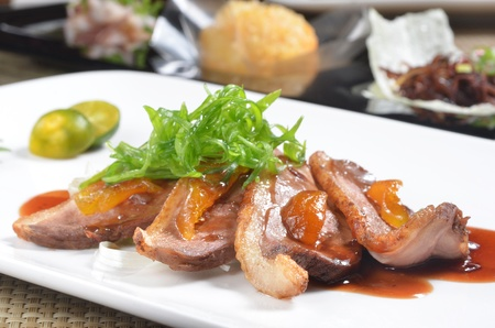 fine dining: slices of duck fried meat on a white plate Stock Photo