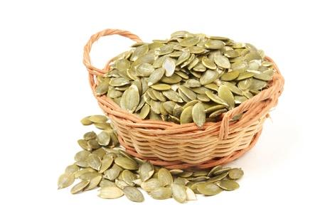 Pumpkin seeds on a white background  photo