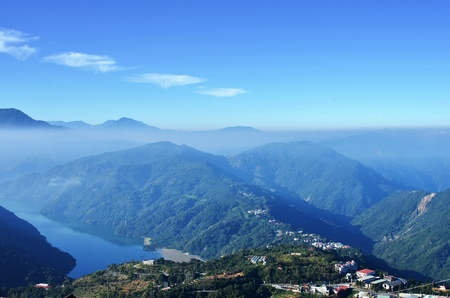 view from mountains to the valley covered with smog     photo