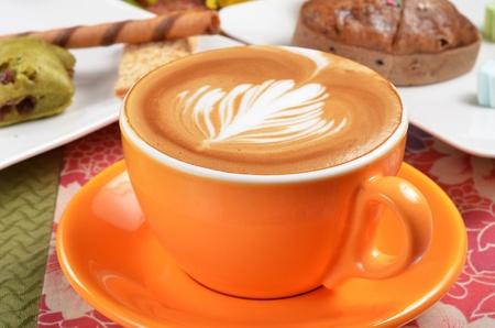 crema: Cappuccino with latte art on the crema.