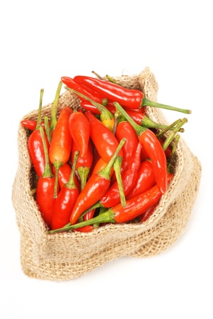 red chilly: Many red peppers on white background    Stock Photo