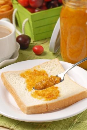 smeared: Pineapple jam smeared on toast          Stock Photo