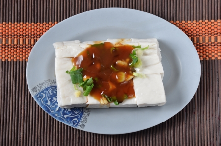 bean curd: Tofu with  soya sauce on a plate  Stock Photo