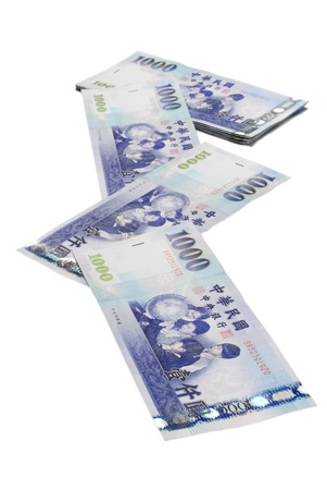 A lot of 1000 New Taiwan Dollar bill on white  background