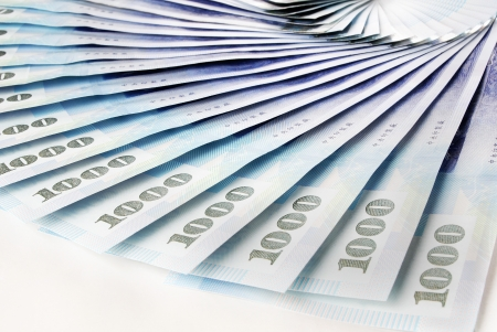 nt: A lot of 1000 New Taiwan Dollar bill on white  background