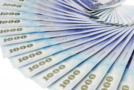 hundreds and thousands:  New Taiwan Dollars bill on white background  Stock Photo