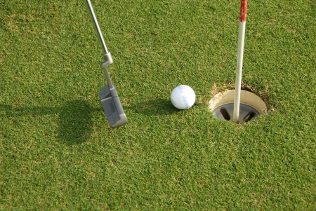putter: A short put in the game of golf