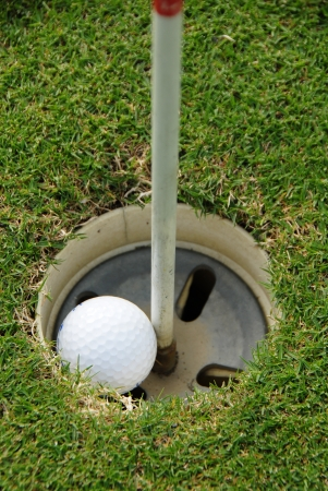 sportsperson: Golf ball hole in one Stock Photo