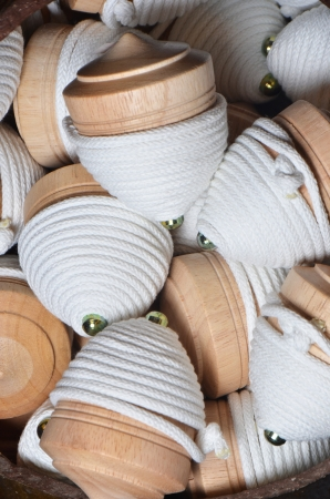 Wooden spinning top toys for sale in a toy store