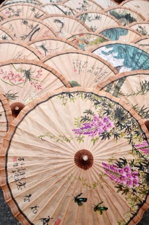 paper umbrella: Paper Umbrella drying on ground  Editorial