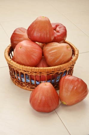 bell shaped: Red rose apple in basket        Stock Photo