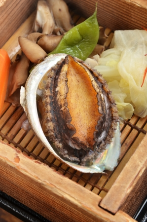 expensive food: abalone, shellfish, mollusk, soft, shell, expensive,  oriental,   petite, restaurant, aromatic, light, steamed, serving, gourmet,  simple, vegetable, small, healthy,  catering, cuisine,  food, asian, seafood