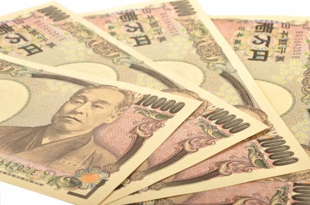 yen: Japanese  10000 yen bill on white background