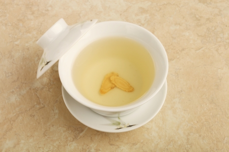 A cup of  ginseng tea on the table