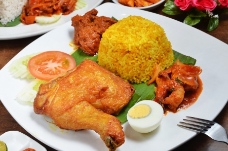 biryani: Biryani rice  with fried chicken drumstick and egg