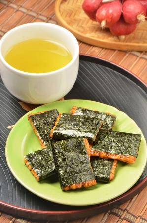 rice cake: Norimaki senbei and green tea on a tray,