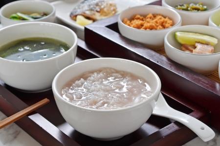 Traditional chinese  rice  porridge on dinner table   Foto de archivo