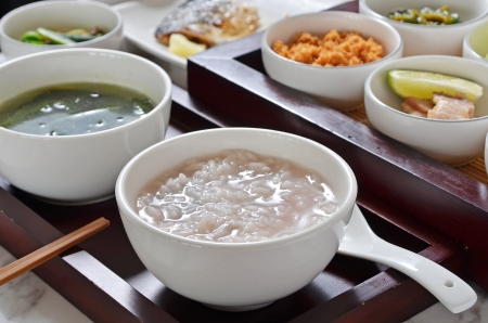 Traditional chinese  rice  porridge on dinner table   Banco de Imagens