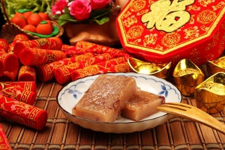botanas: Platos tradicionales de Año Nuevo s de China s, rojo pastel de arroz de frijoles